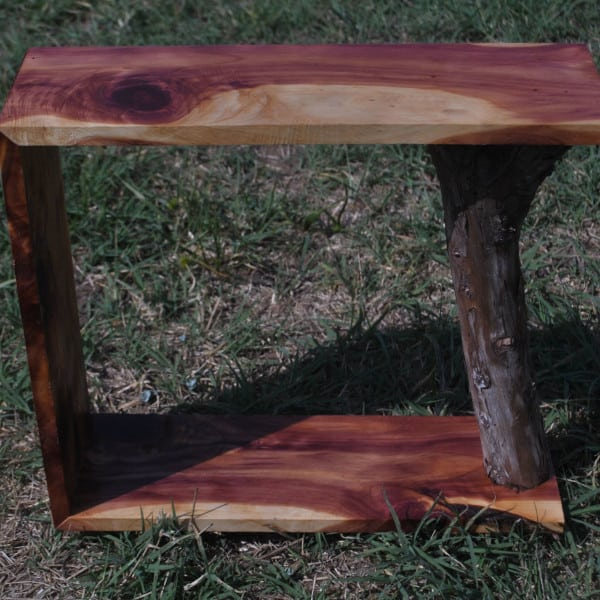 small cedar shelf with bark handcrafted