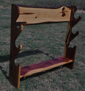 Cedar gun rack with coat hooks